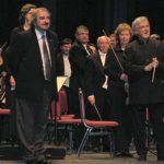 photo of Peter Koprowski with Maestro Pinchas Zukerman and National Arts Centre Orchestra following performance of In Memoriam Karol Szymanowski in Ottawa, Canada, 2011