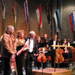 photo of Peter Koprowski with conductor Glen Fast, soprano Maria Knapik and Kingston Symphony following performance of Tapestries of Love in Kingston, Canada, 2007